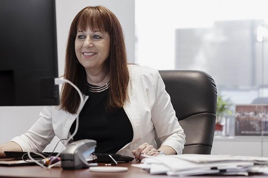 Rose Zubik working alone at her desk